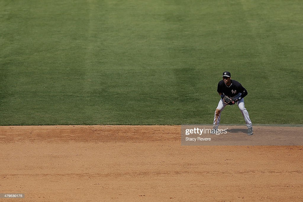 Derek Jeter #2 of the New York Yankees waits for a play in the fifth inning of a game against the Boston Red Sox at George M. Steinbrenner Field on March 18, 2014 in Tampa, Florida.