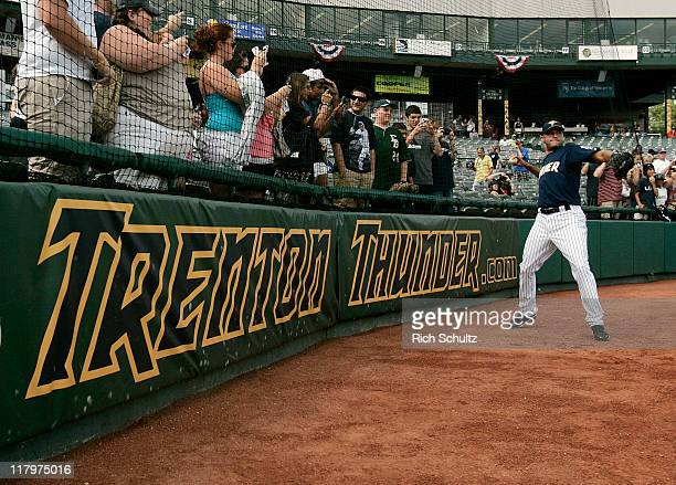 Derek Jeter of the New York Yankees warms up before the start of his minor league rehab start with the Trenton Thunder in a game against the Altoona...