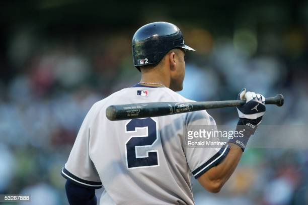 Derek Jeter of the New York Yankees warms up on deck during the game with the Texas Rangers on July 19 2005 at Ameriquest Field in Arlington in...