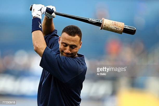 Derek Jeter of the New York Yankees warms up on the field before Game Four of the American League Division Series against the Cleveland Indians at...