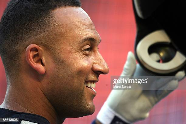 Derek Jeter of the New York Yankees warms up prior to a game against the Florida Marlins at Landshark Stadium on June 19 2009 in Miami Florida The...