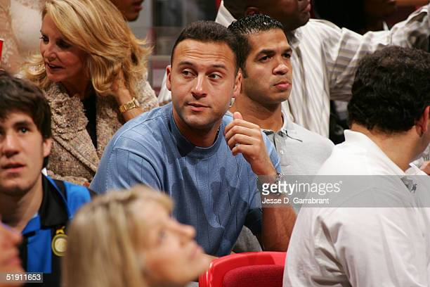 Derek Jeter of the New York Yankees watches the game between the Miami Heat and the Seattle SuperSonics on January 3 2005 at the American Airlines...