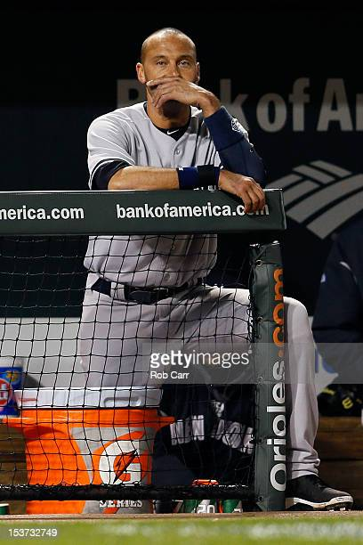 Derek Jeter of the New York Yankees watches the ninth inning from the dugout during of the Yankees 32 loss during Game Two of the American League...