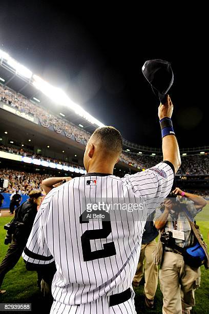 Derek Jeter of the New York Yankees waves to fans after the last regular season game at Yankee Stadium on September 21 2008 in the Bronx borough of...