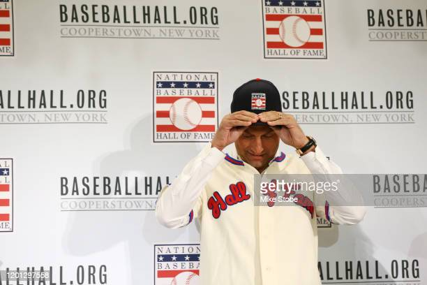 Derek Jeter puts on his Hall of Fame hat after being elected into the National Baseball Hall of Fame Class of 2020 on January 22, 2020 at the St....