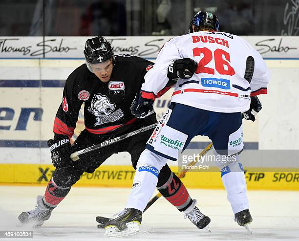 Derek Joslin of the Thomas Sabo Ice Tigers Nuernberg and Florian Busch of the Eisbaeren Berlin in action during the game between Thomas Sabo Ice...