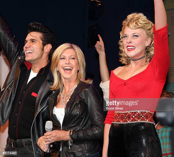 Derek Keeling Olivia NewtonJohn and Ashley Spencer during the curtain call at Grease on Broadway to promote Breast Cancer Awareness Month at the...