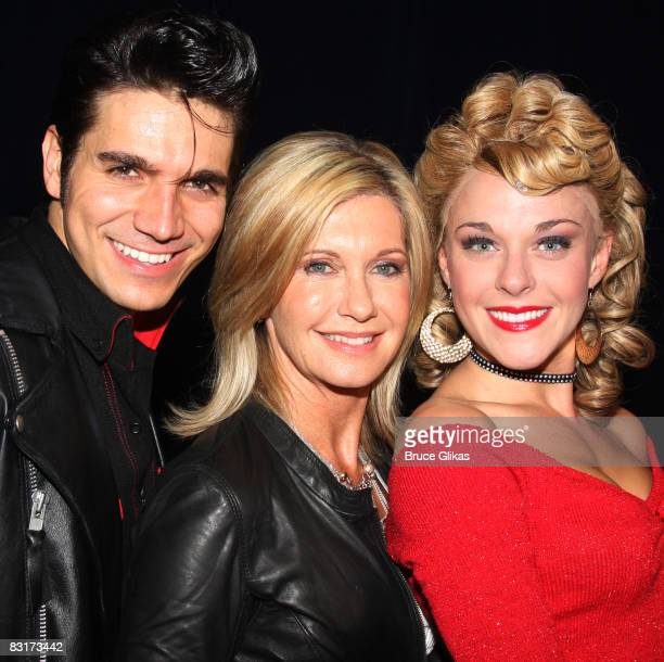 Derek Keeling Olivia NewtonJohn and Ashley Spencer pose backstage at Grease to promote Breast Cancer Awareness Month at the Brooks Atkinson Theatre...
