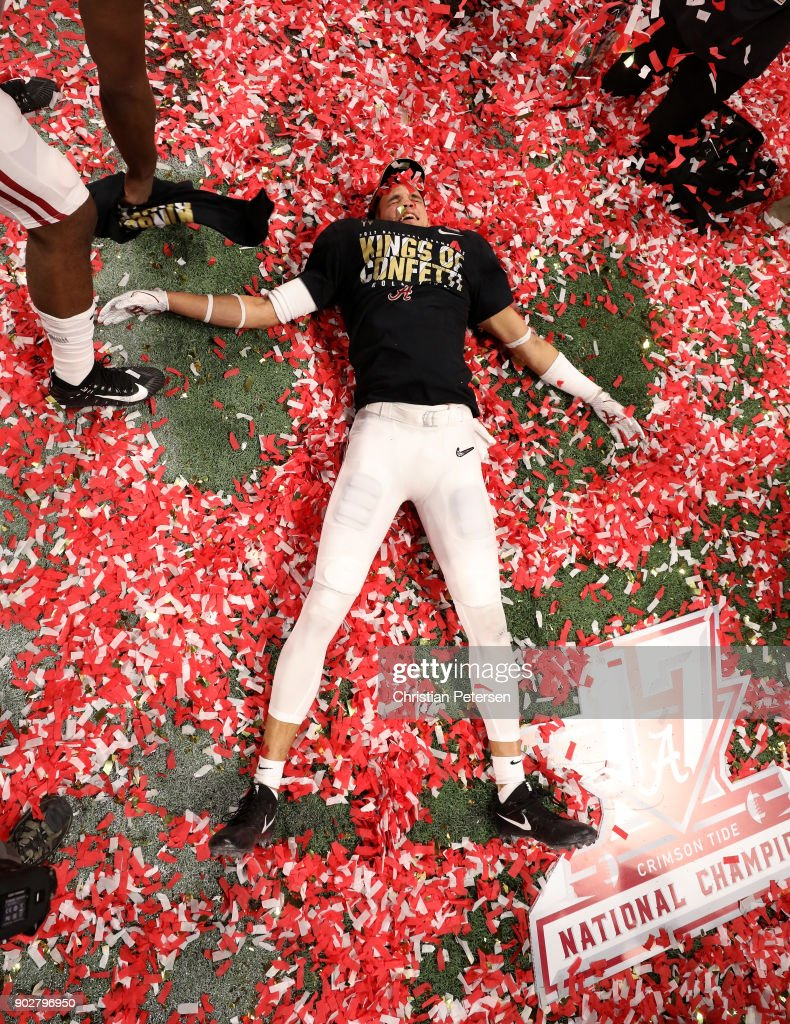 Derek Kief #81 of the Alabama Crimson Tide celebrates beating the Georgia Bulldogs in overtime to win the CFP National Championship presented by AT&T at Mercedes-Benz Stadium on January 8, 2018 in Atlanta, Georgia. Alabama won 26-23.