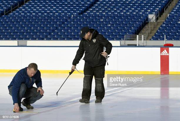 Derek King left senior manager of facilities operations and hockey operations for the NHL and Jeff Fletcher ice crew member prepare NavyMarine Corps...