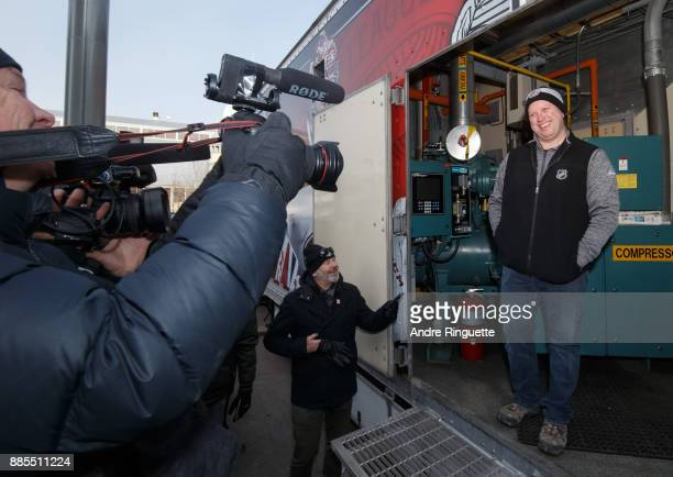 Derek King NHL Senior Manager of Facility Operations answers questions during media availability in the Ice Plant truck during rink buildout ahead of...