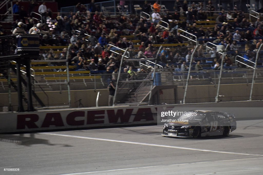 Derek Kraus, driver of the #19 Carlyle Tools Toyota, takes the checkered flag during the NASCAR K&N Pro Series West Coast Stock Car Hall of Fame Championship 150, presented by NAPA Auto Parts at Kern County Raceway Park on November 4, 2017 in Bakersfield, California.