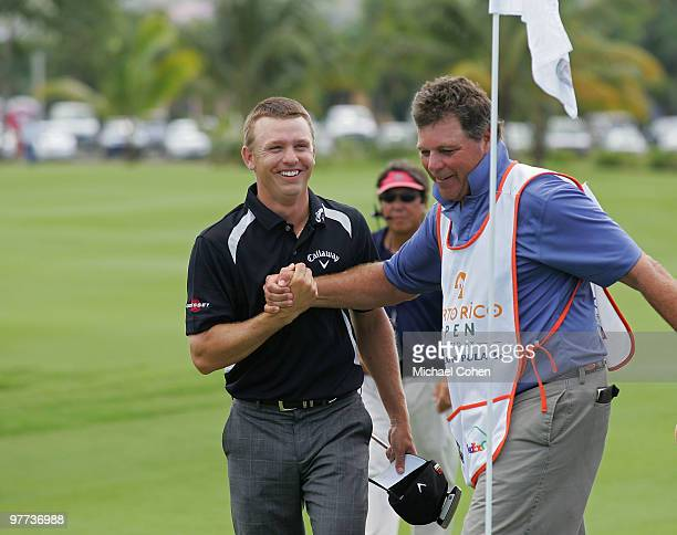 Derek Lamely celebrates with his caddie Greg Hickman after finishing his round on the ninth green during the final round of the Puerto Rico Open...