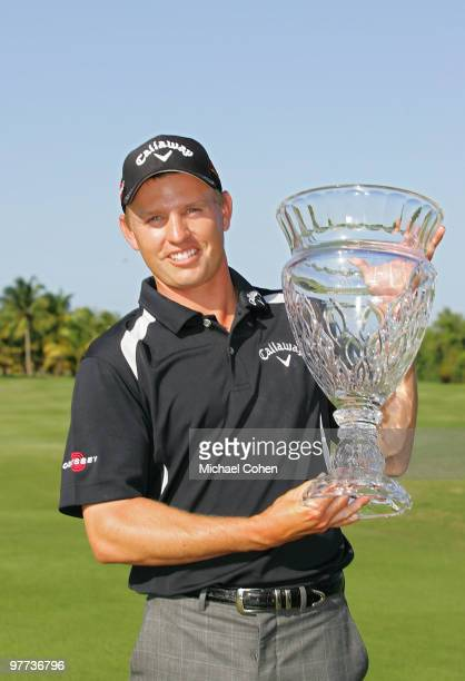 Derek Lamely holds the trophy after winning the Puerto Rico Open presented by Banco Popular at Trump International Golf Club held on March 15 2010 in...