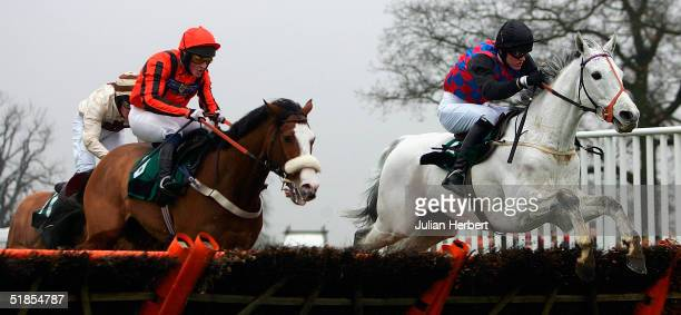Derek Laverty and Luminoso lead the Lee Vickers ridden Protocol to land The Wayside Selling Handicap Hurdle Race run at Towcester Racecourse on...