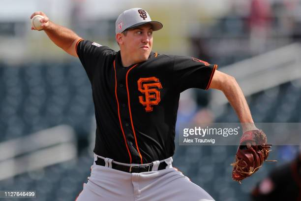 Derek Law of the San Francisco Giants pitches during a Spring Training game against the Cincinnati Reds on Tuesday February 26 2019 at Goodyear...
