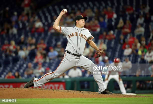 Derek Law of the San Francisco Giants throws a pitch during a game against the Philadelphia Phillies at Citizens Bank Park on May 9 2018 in...
