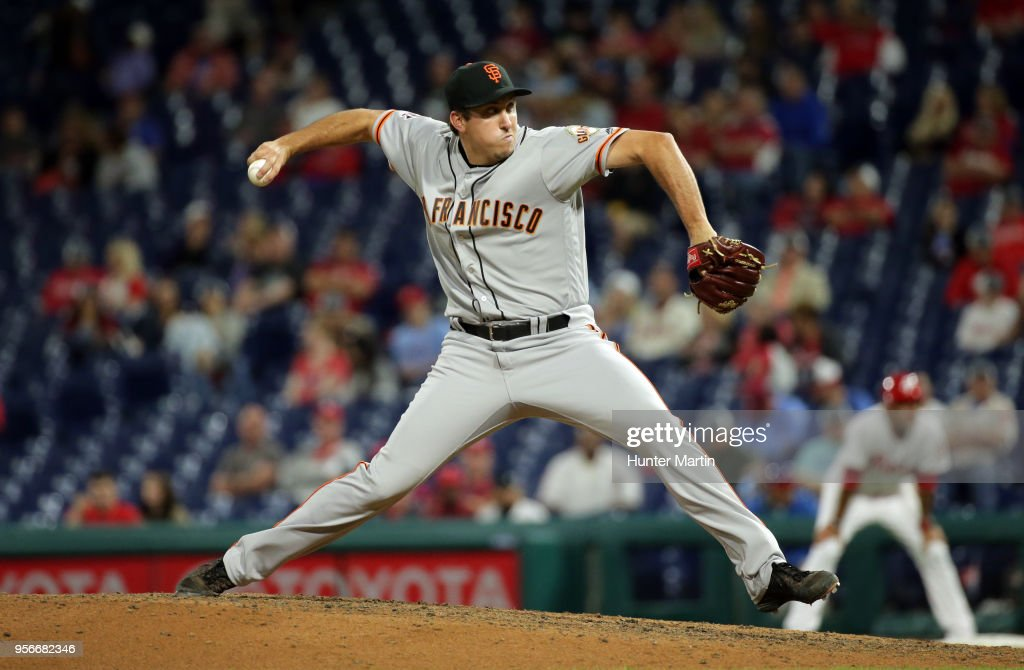 Derek Law of the San Francisco Giants throws a pitch in the seventh inning during a game against the Philadelphia Phillies at Citizens Bank Park on May 9, 2018 in Philadelphia, Pennsylvania. The Phillies won 11-3.