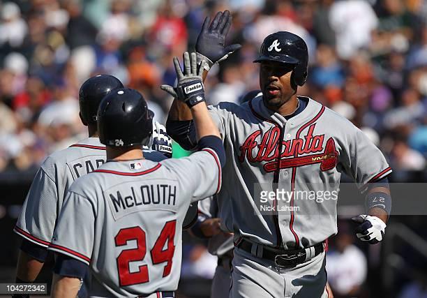 Derek Lee of the Atlanta Braves celebrates his seventh inning grand slam home run against the New York Mets at Citi Field on September 19 2010 in the...