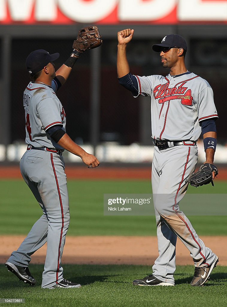 Derek Lee #27 of the Atlanta Braves celebrates the win with teammate Martin Prado #14 against the New York Mets at Citi Field on September 19, 2010 in the Flushing neighborhood of the Queens borough of New York City.