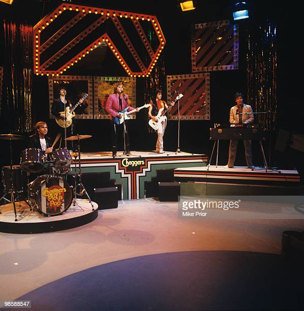 Derek Longmuir Eric Faulkner Duncan Faure Stuart Wood and Alan Longmuir of the Bay City Rollers perform on 'Cheggers Plays Pop' television show...