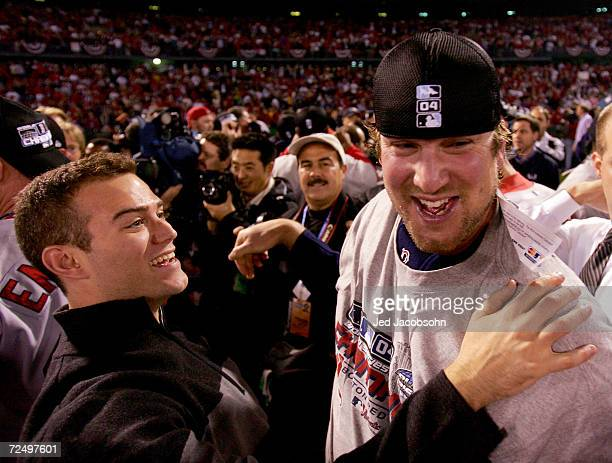 Derek Lowe and general manager Theo Epstein of the Boston Red Sox celebrate after defeating the St Louis Cardinals 30 in game four of the World...