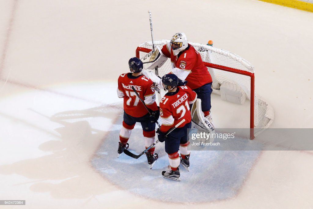 Derek MacKenzie #17 and Vincent Trocheck #21 congratulate Goaltender Roberto Luongo #1 of the Florida Panthers after the game against the Boston Bruins at the BB&T Center on April 5, 2018 in Sunrise, Florida. The Panthers defeated the Bruins 3-2.