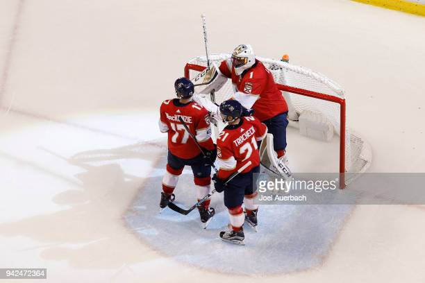 Derek MacKenzie and Vincent Trocheck congratulate Goaltender Roberto Luongo of the Florida Panthers after the game against the Boston Bruins at the...