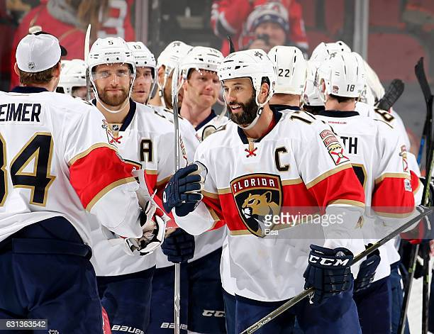 Derek MacKenzie of the Florida Panthers and the rest of the team celebrates the win over the New Jersey Devils on January 9 2017 at Prudential Center...