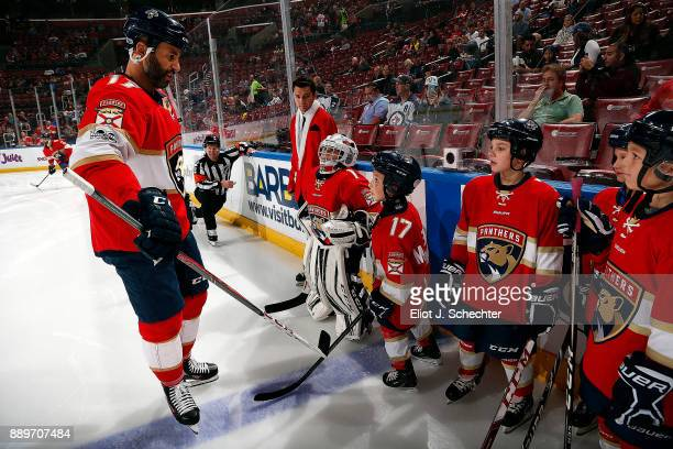 Derek MacKenzie of the Florida Panthers chats with his Son Greyson and Daughter Reese on the ice prior to the start of the game against the Winnipeg...