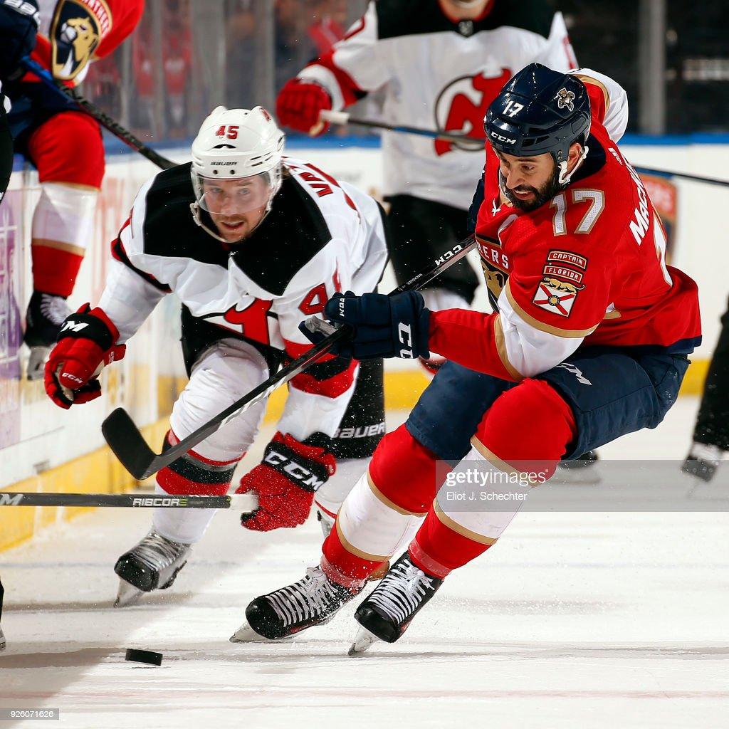 6af2dc85f11 Derek MacKenzie of the Florida Panthers skates for possession ...