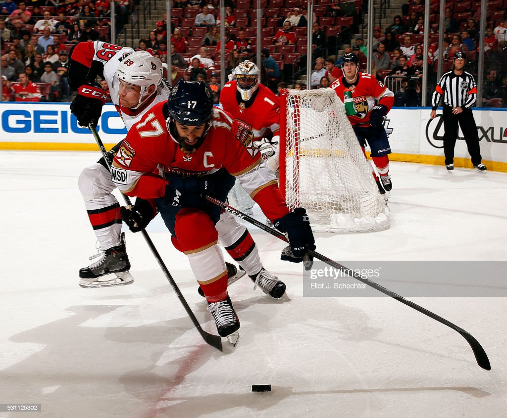 Derek MacKenzie #17 of the Florida Panthers skates for possession against Max McCormick #89 of the Ottawa Senators at the BB&T Center on March 12, 2018 in Sunrise, Florida.