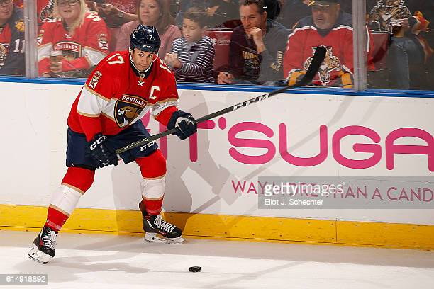 67ddc640e48 Derek MacKenzie of the Florida Panthers skates with the puck against the New  Jersey Devils at