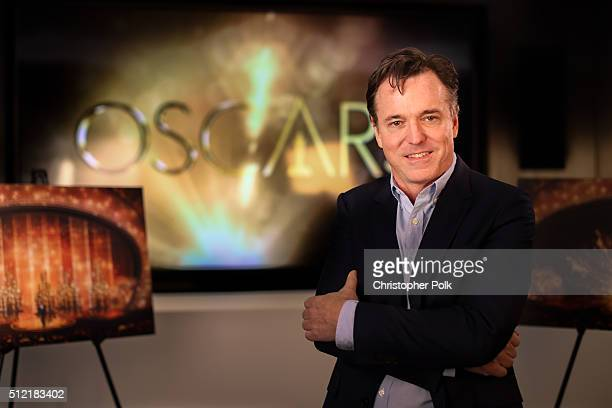 Derek Mclane stands in front of artist renderings of this years Oscars stage at the Dolby Theatre on February 24 2016 in Hollywood California McLane...