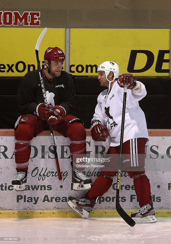 Derek Morris #53 and Steve Sullivan of the Phoenix Coyotes participate in a workout at the Ice Den on December 3, 2012 in Scottsdale, Arizona.