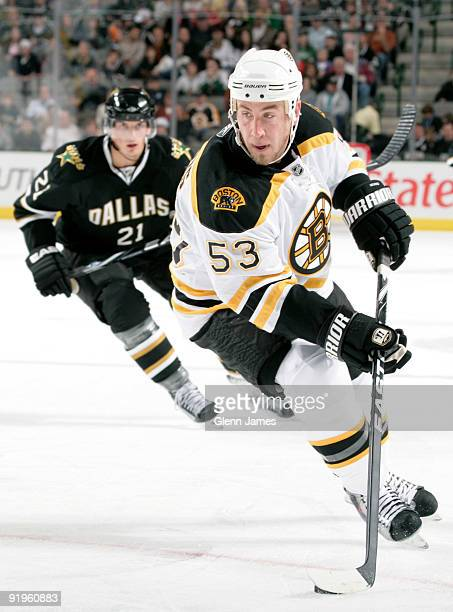 Derek Morris of the Boston Bruins handles the puck against Loui Eriksson and the Dallas Stars on October 16 2009 at the American Airlines Center in...