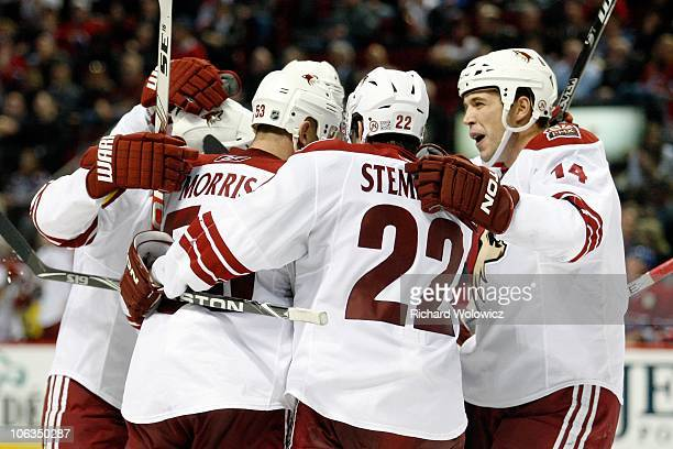 Derek Morris of the Phoenix Coyotes celebrates his third period goal with team mates during the NHL game against the Montreal Canadiens at the Bell...
