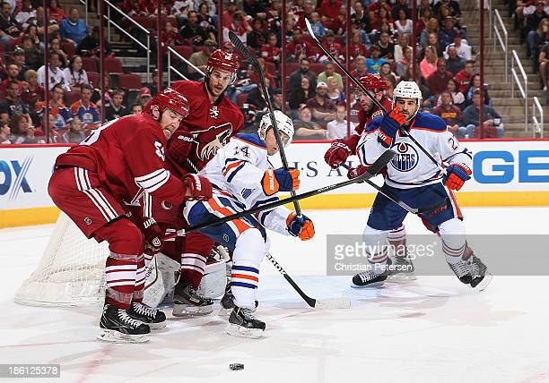 Derek Morris of the Phoenix Coyotes defends against Jordan Eberle of the Edmonton Oilers during the NHL game at Jobingcom Arena on October 26 2013 in...
