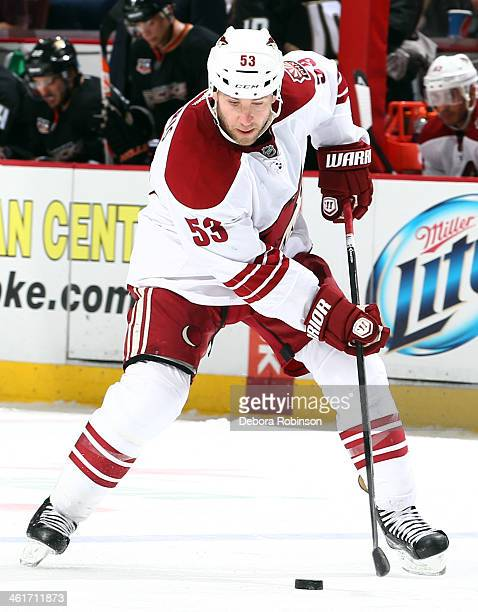 Derek Morris of the Phoenix Coyotes handles the puck during the game against the Anaheim Ducks on December 28 2013 at Honda Center in Anaheim...