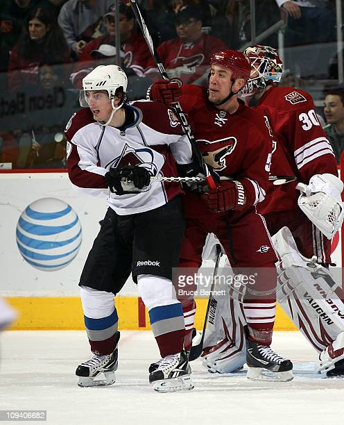 Derek Morris of the Phoenix Coyotes hangs onto Matt Duchene of the Colorado Avalanche at the Jobingcom Arena on February 7 2011 in Glendale Arizona