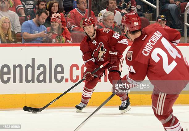 Derek Morris of the Phoenix Coyotes looks to pass the puck against the Chicago Blackhawks at Jobing.com Arena on February 7, 2014 in Glendale,...