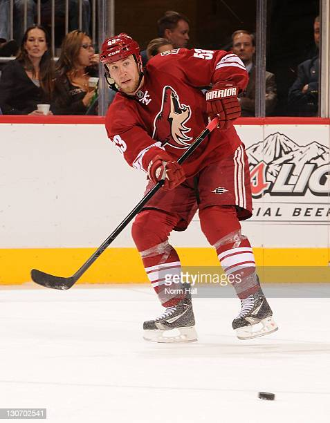 Derek Morris of the Phoenix Coyotes passes the puck across the ice against the Dallas Stars at Jobingcom Arena on October 25 2011 in Glendale Arizona