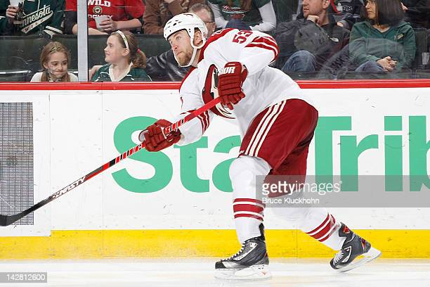 Derek Morris of the Phoenix Coyotes passes the puck against the Minnesota Wild during the game at the Xcel Energy Center on April 7 2012 in St Paul...