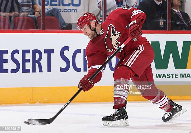 Derek Morris of the Phoenix Coyotes shoots the puck during the first period of the NHL game against the Edmonton Oilers at Jobingcom Arena on October...