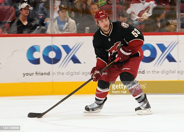 Derek Morris of the Phoenix Coyotes skates the puck up ice against the Vancouver Canucks at Jobingcom Arena on November 25 2011 in Glendale Arizona