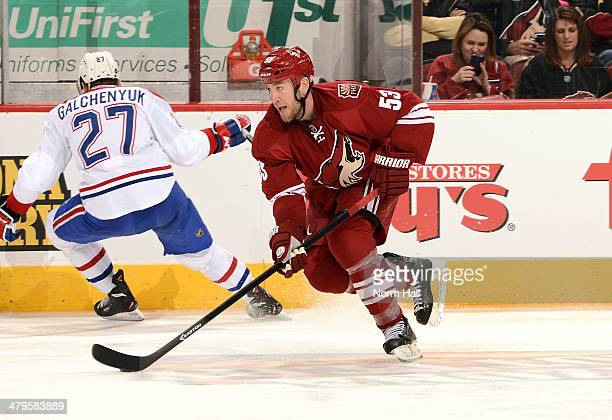 Derek Morris of the Phoenix Coyotes skates the puck up ice against the Montreal Canadiens at Jobing.com Arena on March 6, 2014 in Glendale, Arizona.