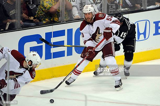 Derek Morris of the Phoenix Coyotes skates with the puck against Brad Richardson of the Los Angeles Kings in Game Four of the Western Conference...