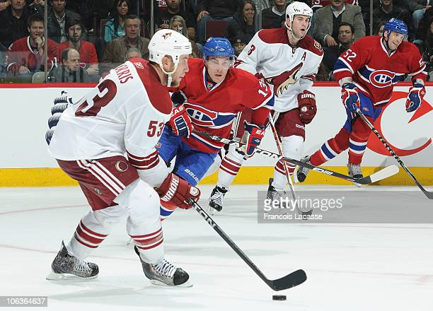 Derek Morris of the Phoenix Coyotes skates with the puck against Michael Cammalleri of the Montreal Canadiens during the NHL game on October 25 2010...