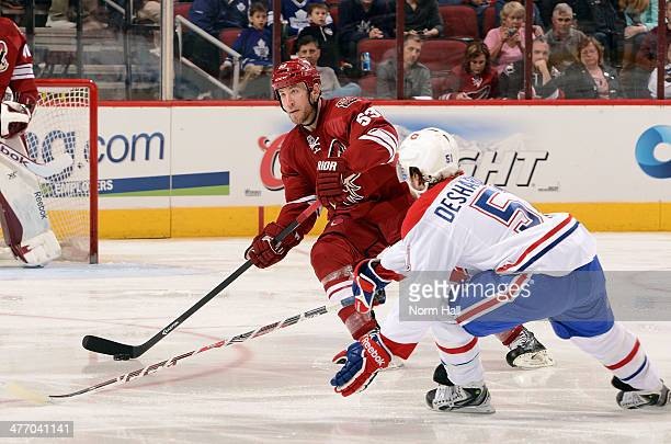 Derek Morris of the Phoenix Coyotes skates with the puck as David Desharnais of the Montreal Canadiens defends during the second period at Jobing.com...