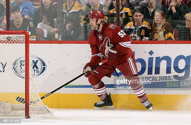 Derek Morris of the Phoenix Coyotes skates with the puck behind the net against the Boston Bruins at Jobing.com Arena on March 22, 2014 in Glendale,...